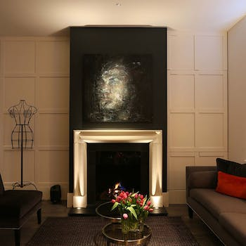 Lucca uplight fireplace surround