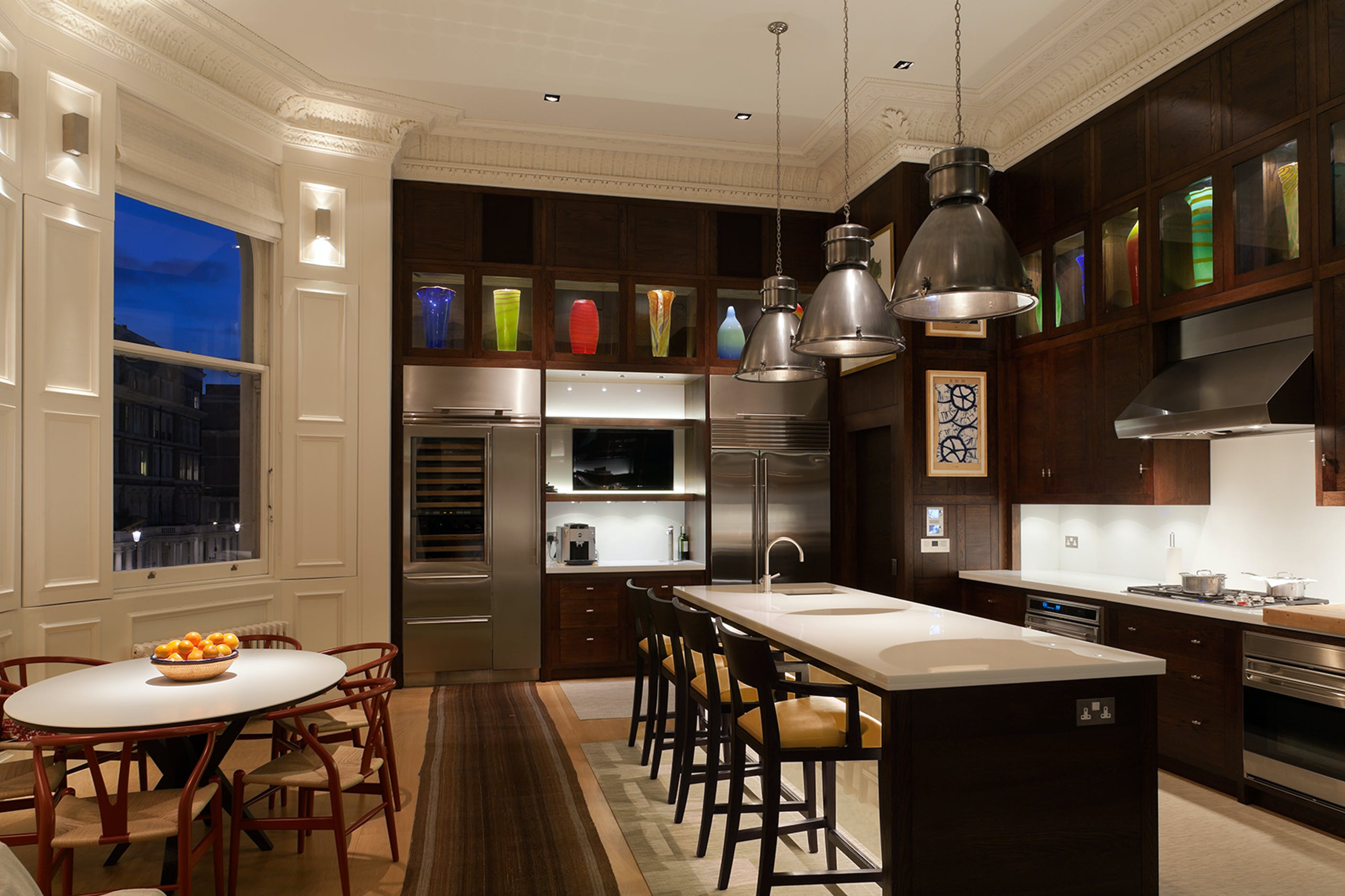 Double height kitchen lighting