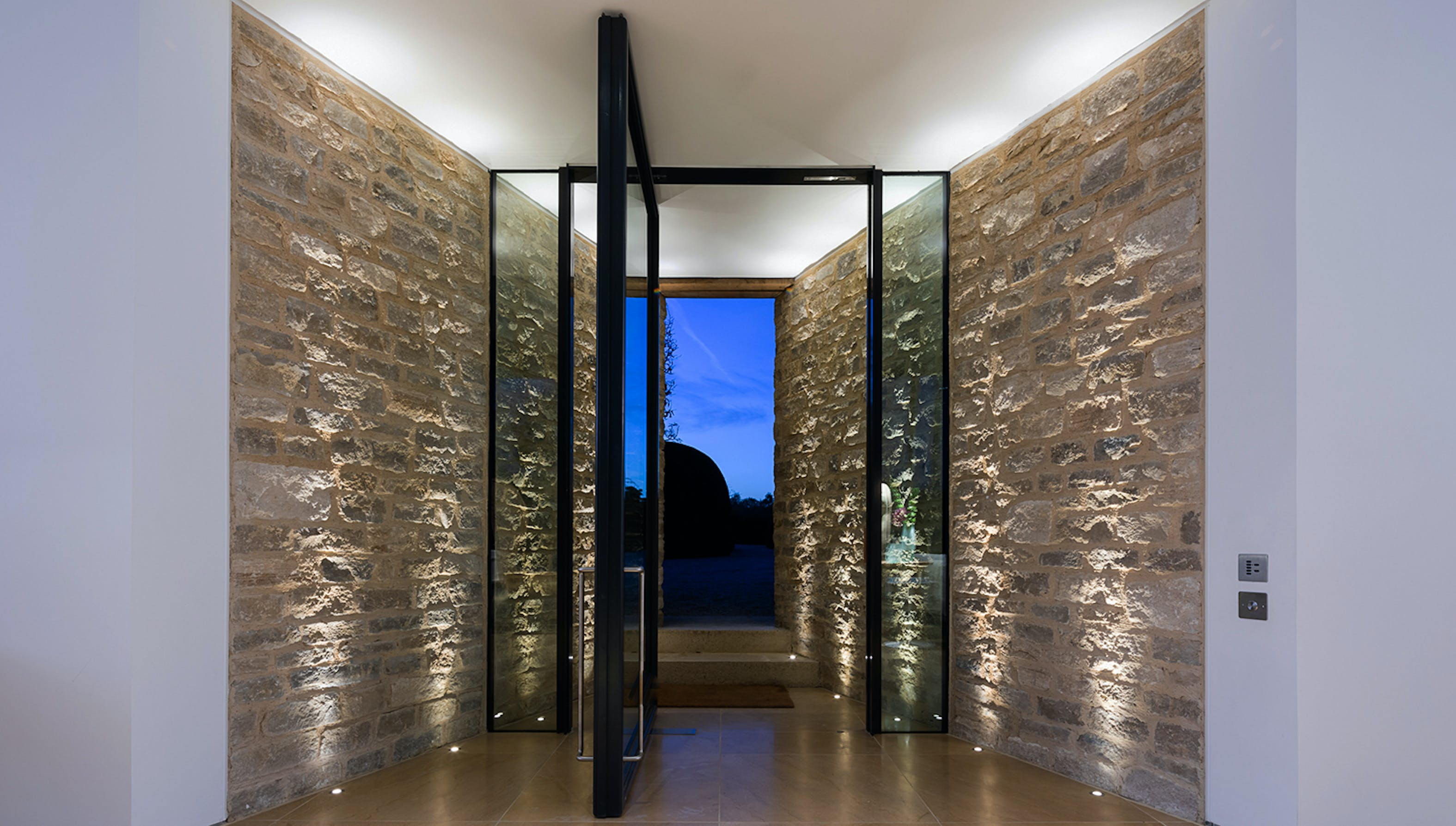 dramatic stone entrance lighting
