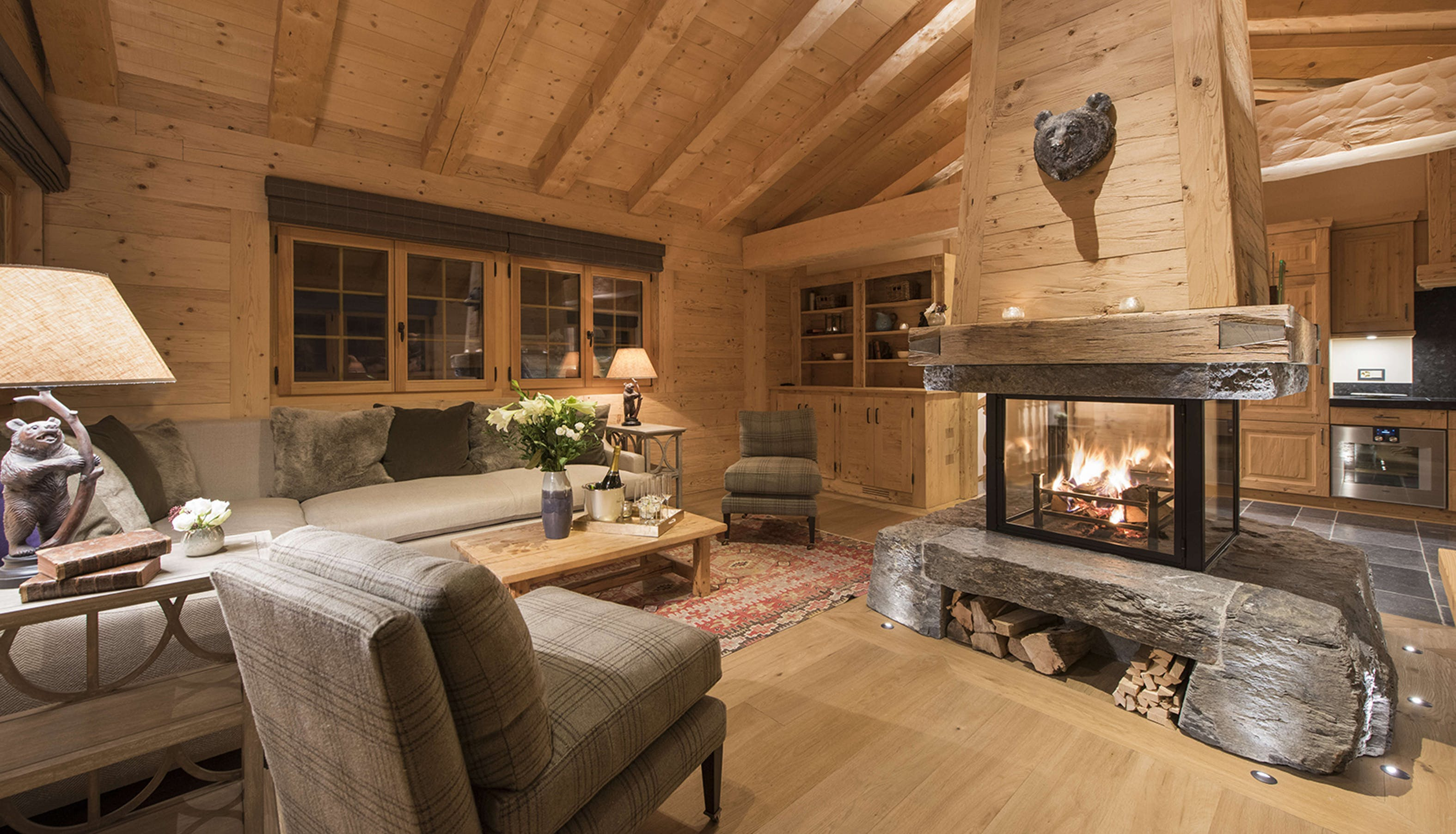 traditional chalet living room and fireplace lighting