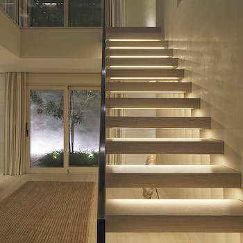 Contemporary hall with linear lighting