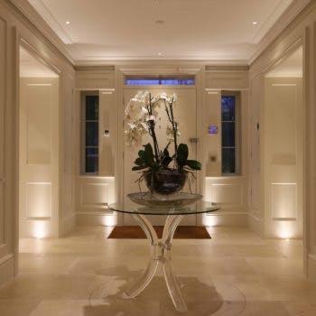 uplit hallway with lit flowers